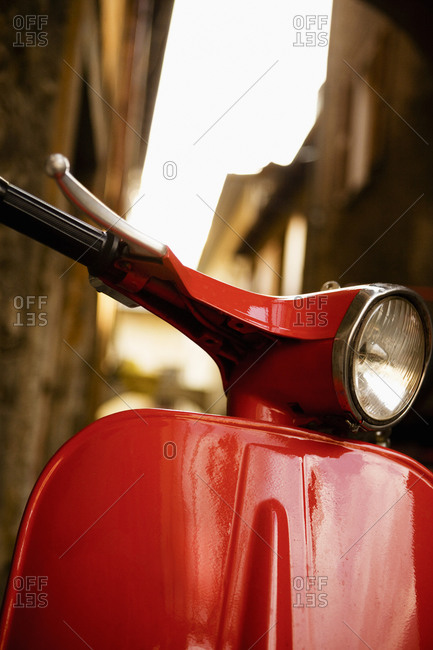 A red motor scooter, Italy