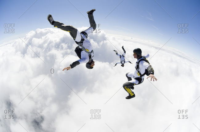 Three parachute jumpers in the sky