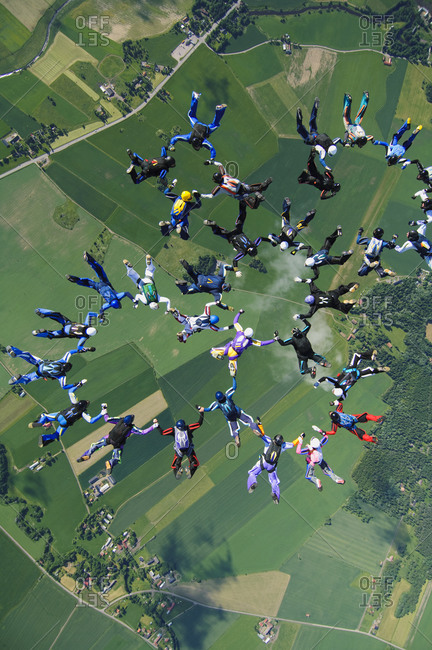 Large group of parachute jumpers in the sky