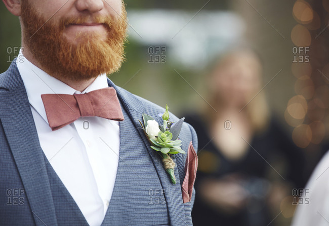 Close up of a groom's boutonniere