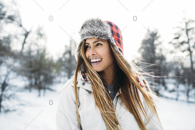 Portrait of a young woman with a plaid furry hat
