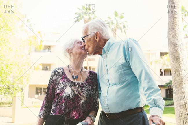 Senior loving couple kissing