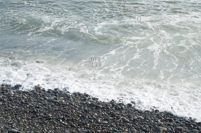 Surf on a pebble beach