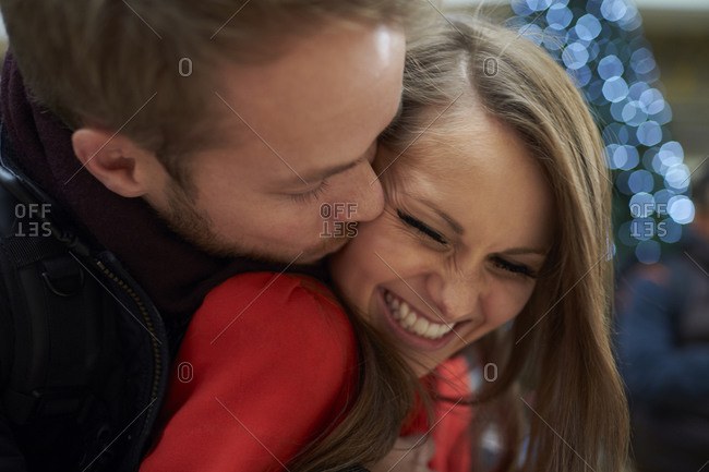 Close up of romantic young couple hugging outdoors