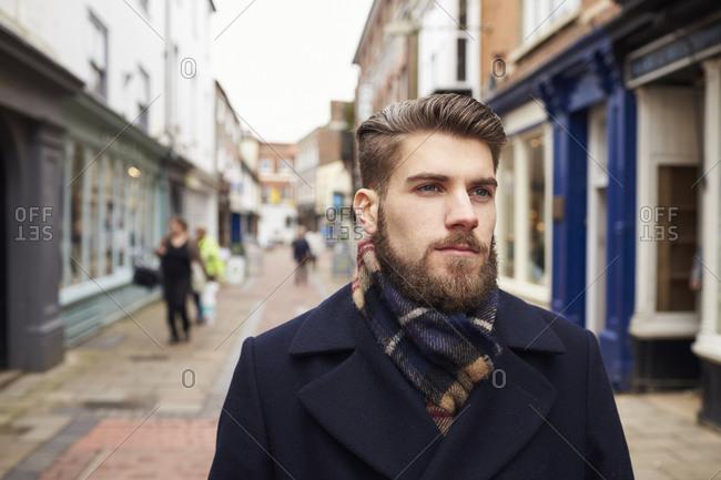 Young man walking down urban street