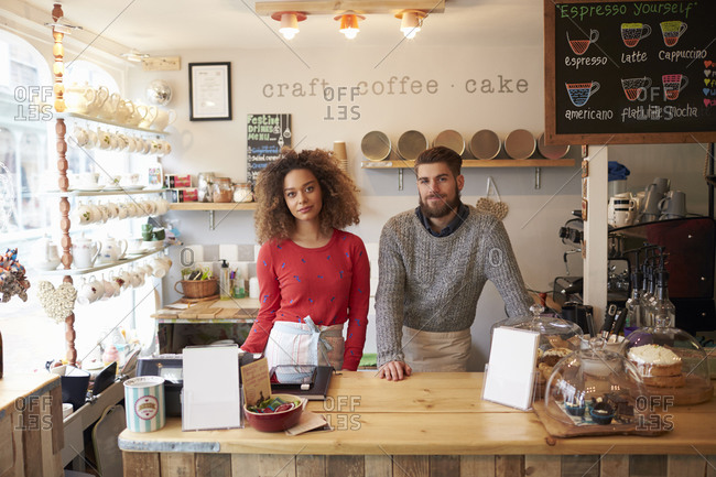 Portrait of young couple running coffee shop