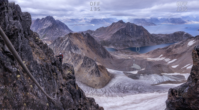 Mountaineers climbing with a rope in the Schweizerland Alps
