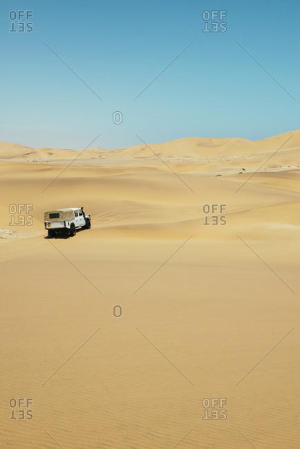 Namibia, Namib desert, Swakopmund, 4x4 car driving among the dunes in the desert