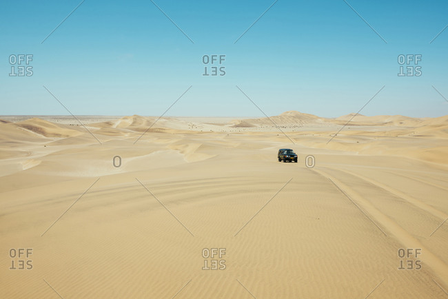 Namibia, Namib desert, Swakopmund, 4x4 car driving among the dunes in the desert