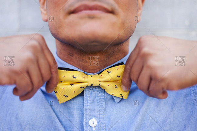 Mature man tying bow tie