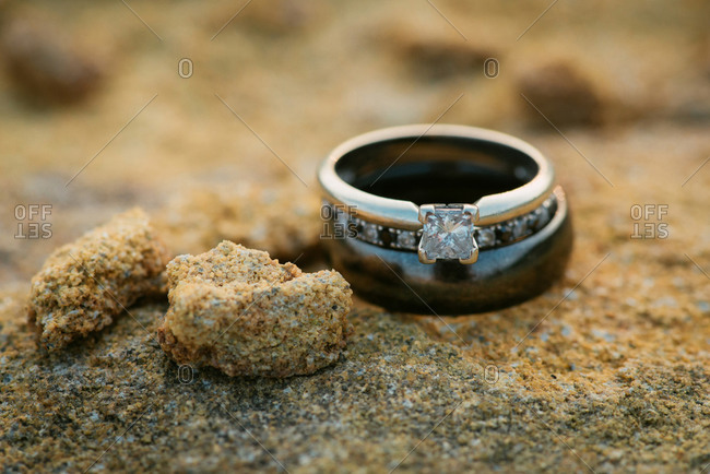 Three wedding rings on rock