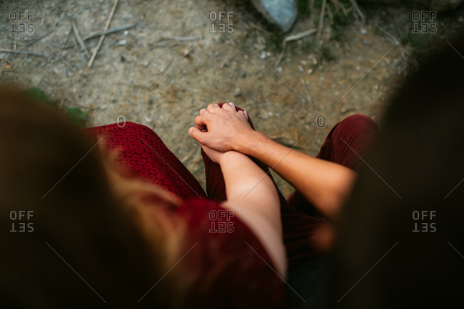 Clasped hands of couple from above