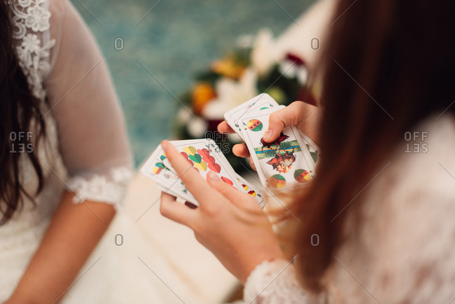 Bride and friend playing cards