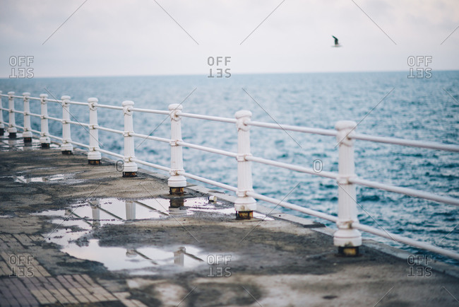 Wet oceanfront walkway