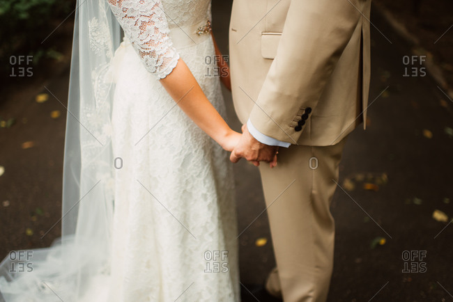 Midsection of bridal couple