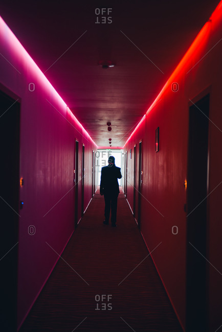 Man in hallway with colored lighting