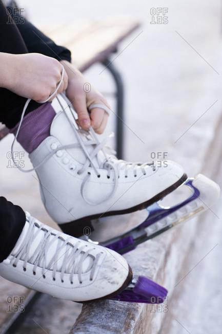 Woman lacing up ice skates