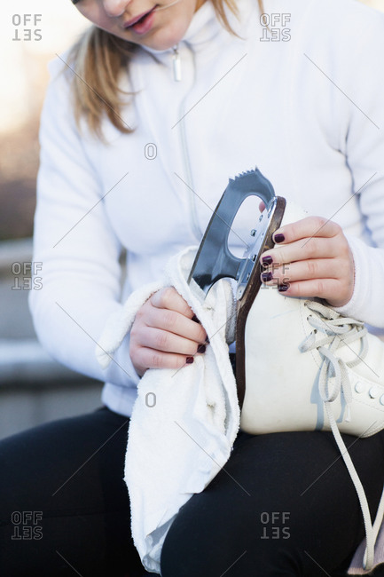 Woman cleaning ice skate