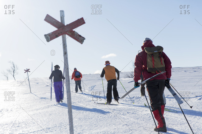 Back view of people cross-country skiing
