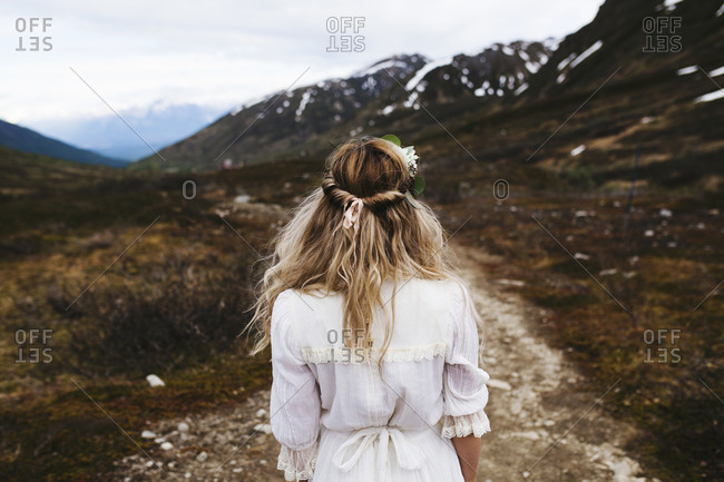 Woman in floral crown in mountains