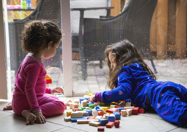 Girls with building block toys