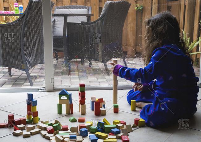 Girl using building block toys