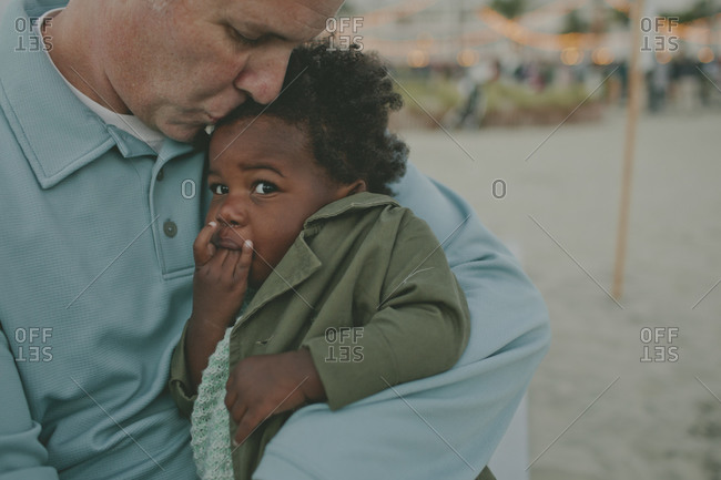 Father kissing baby on the head