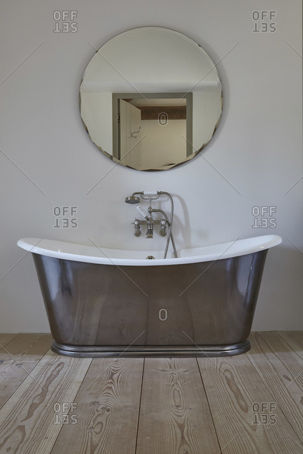Bathtub and mirror in a contemporary bathroom