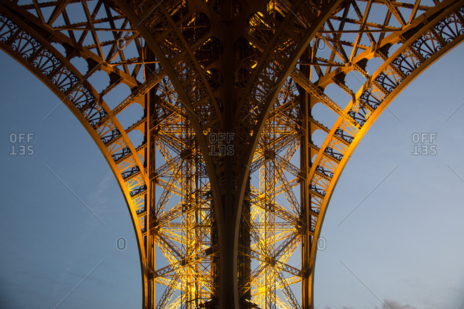 Paris, France - January 28, 2016: Detail of the illuminated base of the Eiffel Tower in Paris