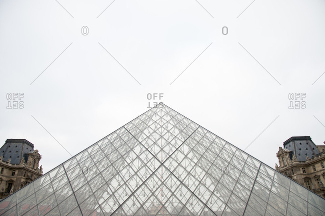 Paris, France - January 29, 2016: Close-up of glass pyramid art museum in Paris