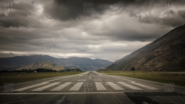 Plane on an airstrip in a mountain valley near Queenstown, New Zealand