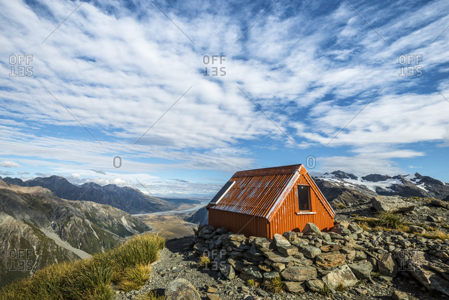 Mountainside bivouac overlooking the vast valley below at Aoraki Mount Cook, New Zealand
