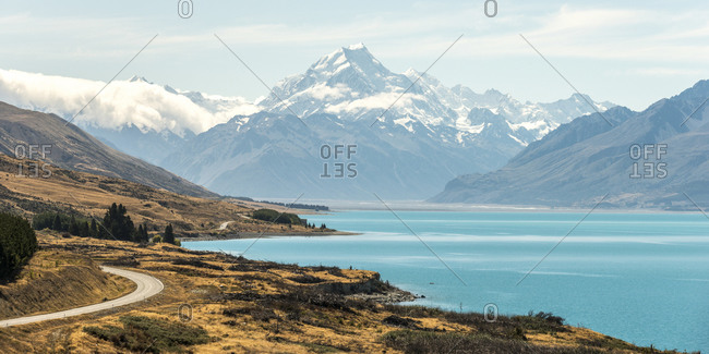 Bright blue lake and distant mountains at Aoraki Mount Cook, New Zealand