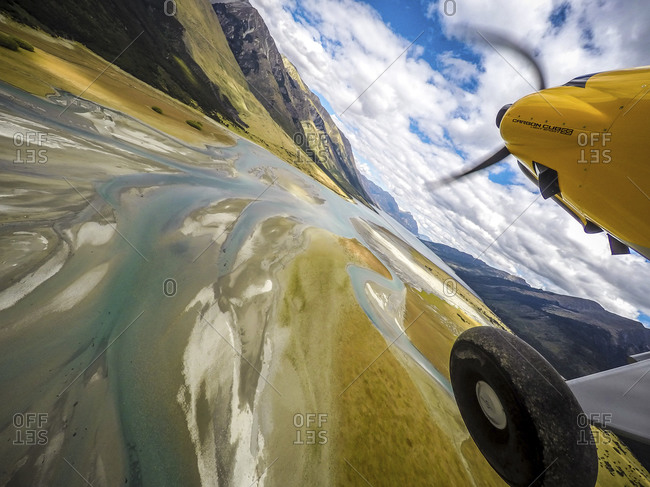 Plane propeller and wheel over wetlands at Lake Hawea, New Zealand