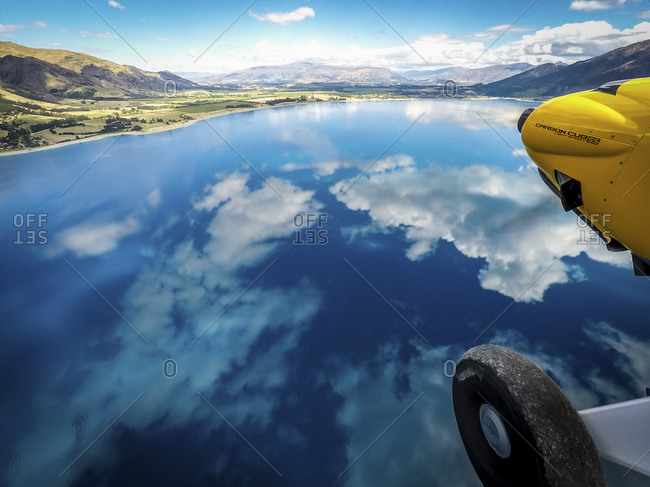 Plane propeller and wheel over cloud reflections at Lake Hawea, New Zealand
