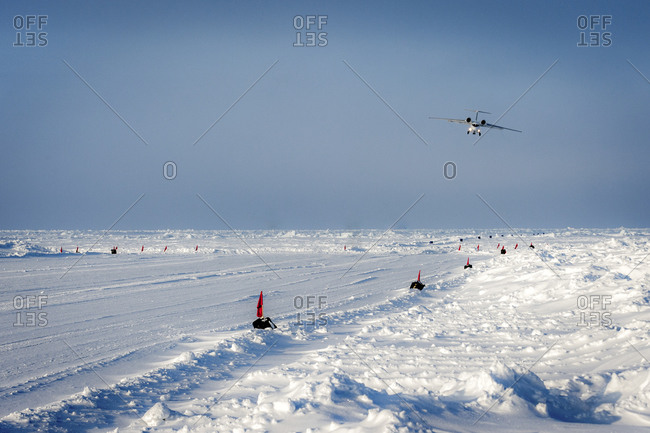 Airplane landing at an ice runway at Barneo, Russia