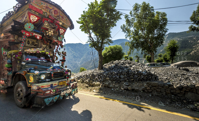 Ornate decorated truck on the Karakoram Highway in the mountains of Pakistan