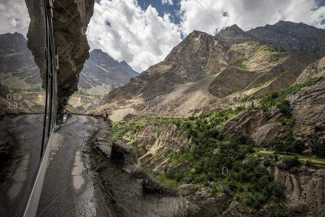 View from a bus of a steep mountain drop on the Karakoram Highway, Pakistan
