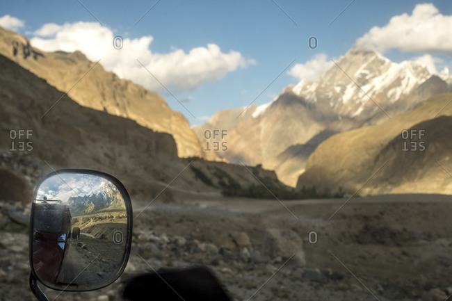 Side mirror on an SUV in a valley of the Karakoram mountains, Pakistan