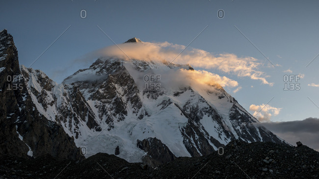 K2 mountain peak and clouds at sunrise
