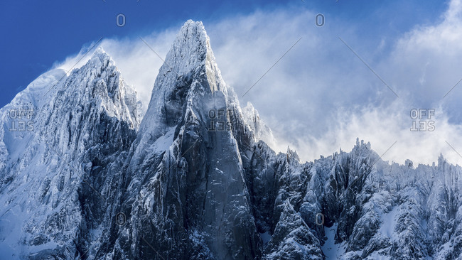 Blue mountain peaks and snow in the French Alps