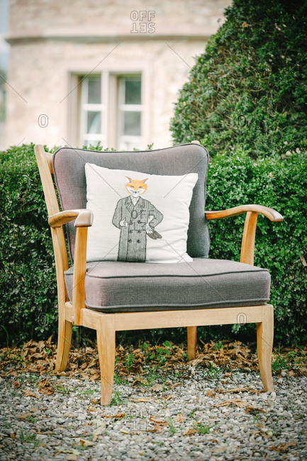 Vintage armchair with fox pillow