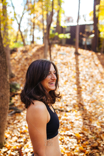 Portrait of a smiling fit woman in autumn woods