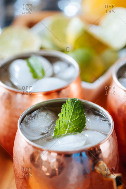 Close up of copper mug of Moscow mule with mint leaf
