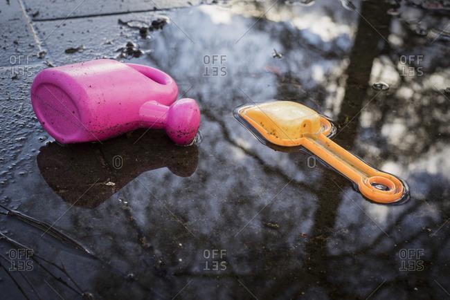 Children's garden toys in puddle