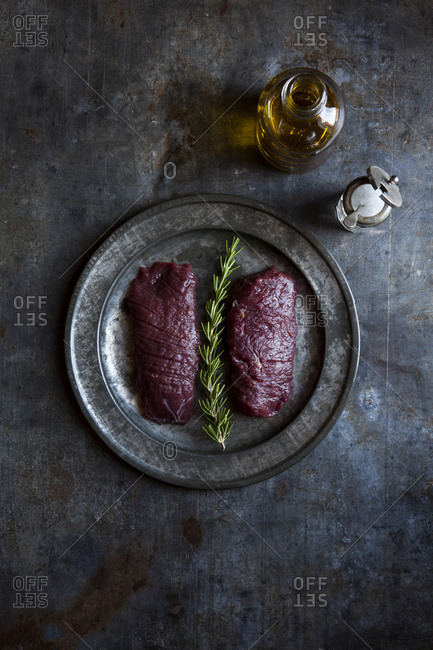 Overhead view of raw ostrich steaks