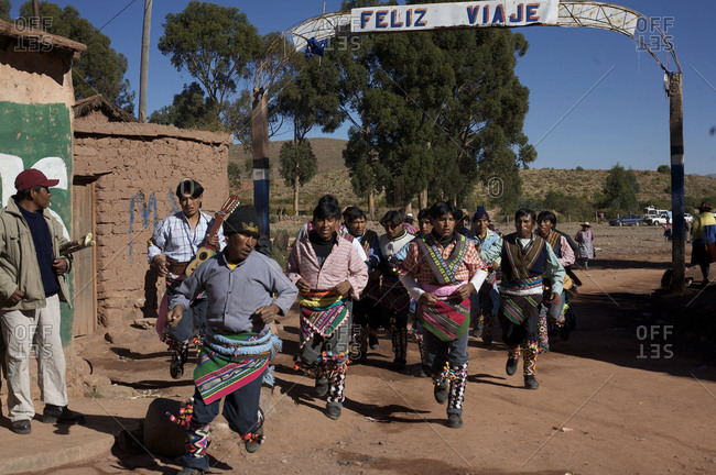 Macha, Bolivia - May 4, 2010: Villagers arrive and run through the streets of Macha during the Tinku Festival in Macha, Bolivia