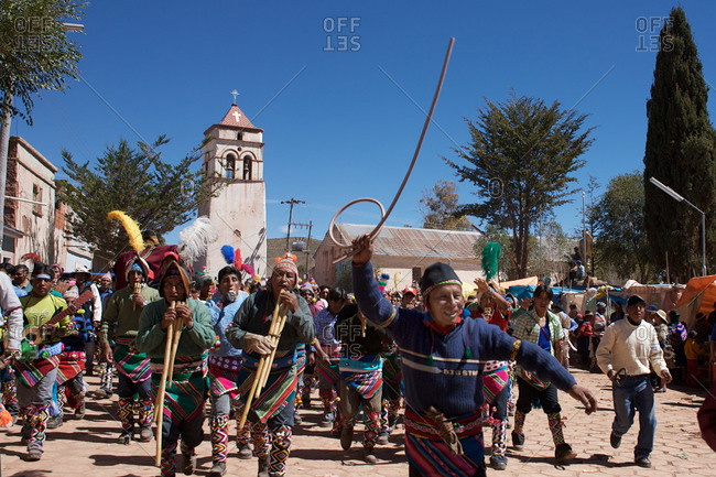 Macha, Bolivia - May 5, 2010: Villagers arrive and run through the streets of Macha during the Tinku Festival
