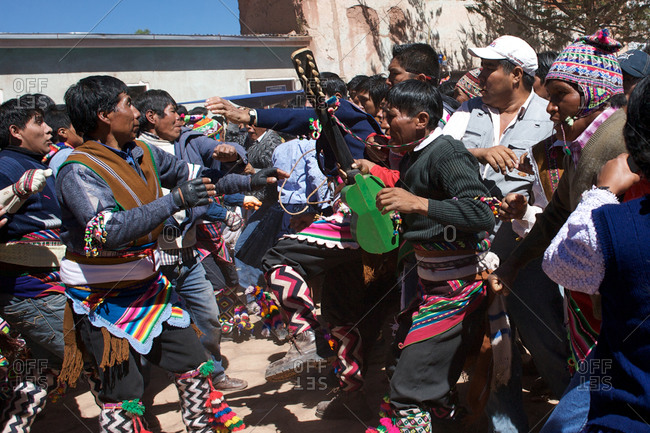 Macha, Bolivia - May 5, 2010: Rival villagers clash in the streets of Macha during the Tinku Festival in Macha, Bolivia