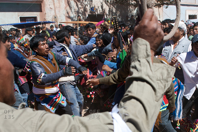 Macha, Bolivia - May 5, 2010: Rival village groups fight during the Tinku Festival in Macha, Bolivia